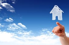 The House In The Hands Against The Blue Sky Royalty Free Stock Photos