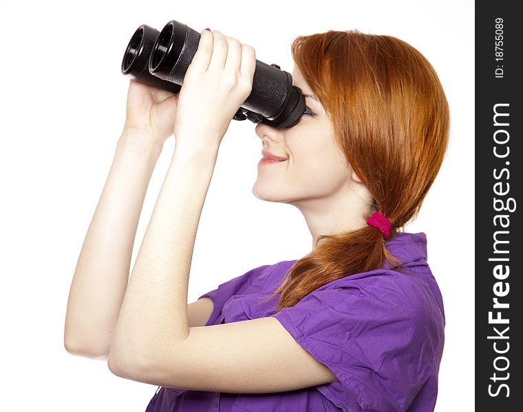 Teen red-haired girl with binoculars