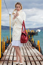 Free Woman In White With Red Bag Sea Footbridge Royalty Free Stock Photo - 18769245