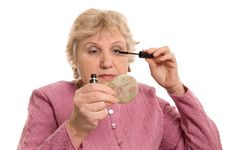 Free The Elderly Woman Does A Make-up Royalty Free Stock Photos - 18760108