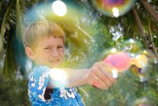 Boy Playing With Bubbles Royalty Free Stock Photography