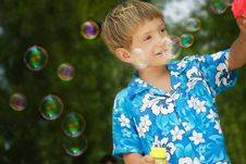 Boy Playing With Bubbles Royalty Free Stock Photo