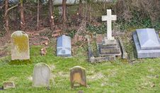 Headstones In A Church Graveyard Royalty Free Stock Photography