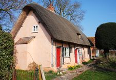Thatched Village Cottage Rendered In Pink Stock Photos