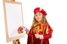 Girl With A Brush And Paints Near An Easel Stock Photo