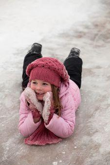 A Girl On Snow Descent Stock Photos