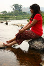 Free Indian Woman In Red Dress Sitting On A Rock Stock Images - 18779144