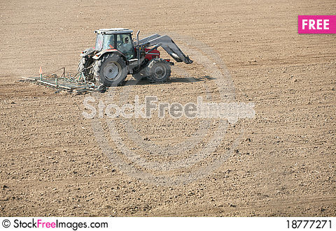Free Tractor On Field Stock Image - 18777271