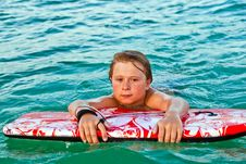 Free Boy Exhausted From Surfing Stock Image - 18770381