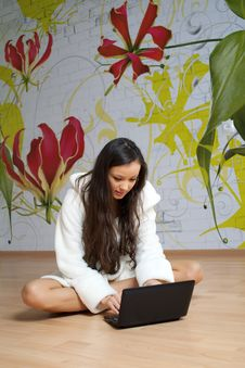A Young Woman In A White Robe With Laptop Royalty Free Stock Images