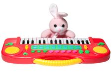 Free Pink Bunny With Synthesizer Stock Photo - 18776900