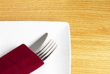 Free Knife And Fork In Red Napkin On Plate Stock Photos - 18777513