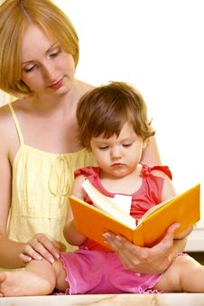 Free Mother With Her Daughter Reading Book Stock Photo - 18778080