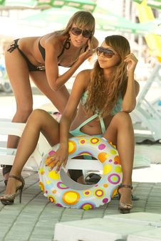 Two Models With Multicolored Inflatable Ring Stock Images