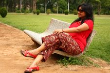 Woman Sitting On Stone Bench In A Park Royalty Free Stock Photo