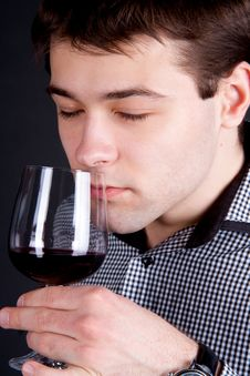 Free Young Man Smelling A Glass Of Red Wine Royalty Free Stock Image - 18779866