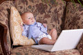 Free Serious Business Baby Near Computer On Sofa Royalty Free Stock Photo - 18789385