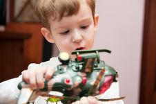 Free Little Boy With Toy Helicopter Stock Images - 18780284