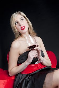 Free Woman With A Glass Of Red Wine Royalty Free Stock Photo - 18781265