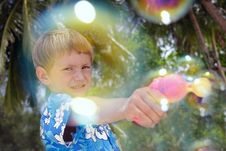 Boy Playing With Bubbles Stock Image