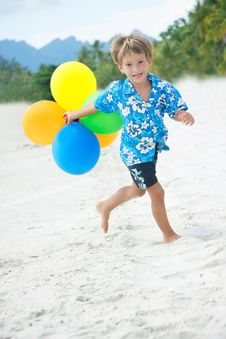Young Happy Boy Running With Balloons Royalty Free Stock Images