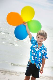Young Happy Boy Running With Balloons Royalty Free Stock Image