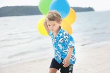 Young Happy Boy Running With Balloons Stock Images