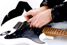 Free Person Tuning A Guitar Royalty Free Stock Photos - 18788248