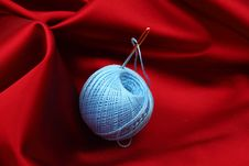Thread On Red Silk Royalty Free Stock Image