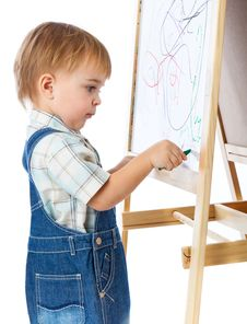 A Boy Is Drawing On A Blackboard Royalty Free Stock Images