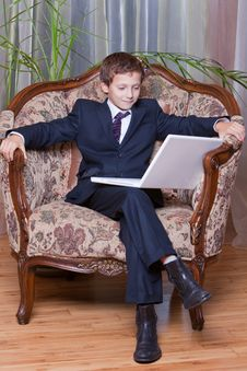Free Smiling Business Boy Dressed Looking At Computer Stock Images - 18789424