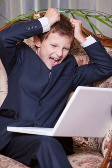 Free Angry Business Boy Screaming At The Computer Stock Photo - 18789430