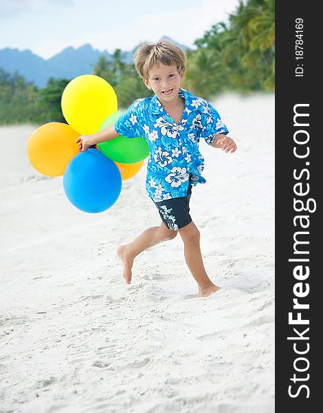 Young happy boy running with balloons