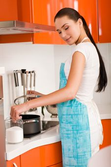 Free Woman Cooking In The Kitchen, Tasting Soup Stock Photos - 18790723