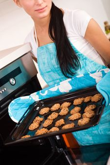 Free Woman In The Kitchen Baking Cookies. Stock Images - 18790784