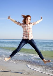 Young Beautiful Girl Jumping At The Beach. Royalty Free Stock Photo