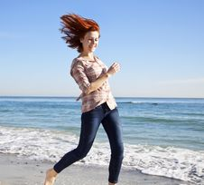 Free Beautiful Young Woman Running On The Beach Royalty Free Stock Images - 18795629