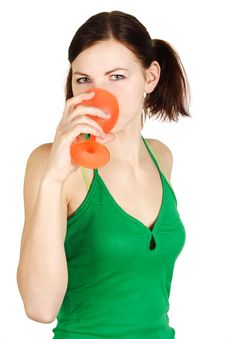 Free Girl In Green Shirt Drinking From Orange Glass Royalty Free Stock Photos - 18799048