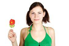 Free Girl In Green Shirt Holding Flower Lollipop Stock Photos - 18799053