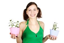 Girl Holding Potted Plants And Smiling Stock Photo