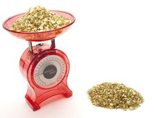 Free Red Kitchen Scales With A Pile Of Gold Stock Photography - 18799632