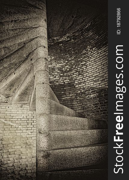 Spiral stone steps and brick wall