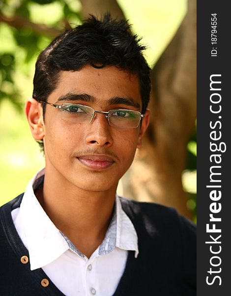 Young Indian Boy with Spiked hair and Specs