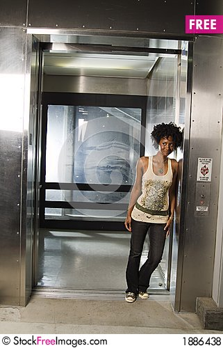 Walking out of elevator 02 Stock Photo