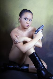 Hopeless Teenage Asian Girl, Naked With A Gun Royalty Free Stock Photos