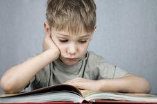 Free Sad Little Reader Stock Image - 1883171