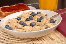 Free A Bowl Of Wheat Cereal With Blueberries, Toast And Orange Juice Royalty Free Stock Photos - 1883838
