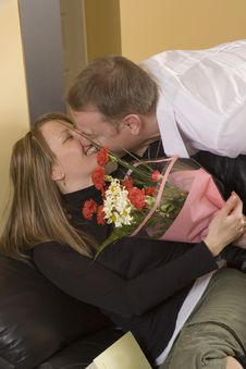 Man Offering A Bouquet To A Woman