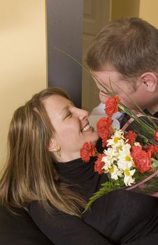Man Offering A Bouquet To A Woman Royalty Free Stock Image