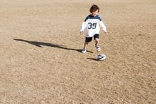 Free Boy Chasing Football Stock Photo - 1888270